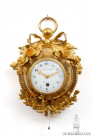 A small French Louis XVI quarter repeating ormolu cartel d'alcove,  circa 1800