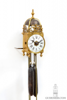 A rare miniature French brass striking and alarm lantern clock, circa 1750