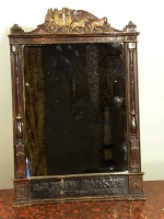 A mirror fitted in a former wooden time table frame, probably USA, ca 1880.
