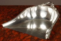 Silver dustpan with a beautifully decorated handle, circa 1880.