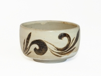 A fine Chinese stoneware cup with brown vegetal design on a white slip and under a clear glaze