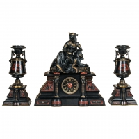 A fantastic black marble 'retour de l'Egypt' mantle clock with two side pieces.