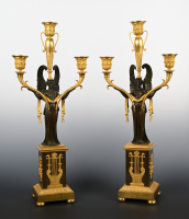 A pair of French fire-gilt and patinated bronze Empire candelabra.