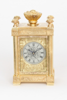 An English engraved gilt brass travel clock, Aubert & Klaftenberger, circa 1860.
