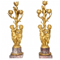 A pair of large gilt bronze and marble figural lamps attributed to E.F. Caldwell, circa 1900