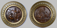 A pair of bronze reliëfs, E. Picault.