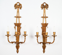 A pair of Dutch carved wall sconces