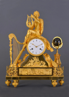 A large French fire-gilt bronze Empire mantel clock Orpheus with its lyre