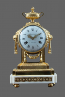 A fire-gilt bronze with white marble Louis Seize mantel clock Guenoux à Paris