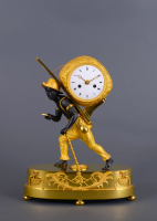 A beautiful French Empire 'au bon sauvage' mantel clock Portefaix