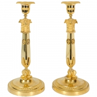 A pair of Russian Empire ormolu candlesticks, circa 1810