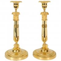 A pair of Russian Empire ormolu candlesticks, circa 1810