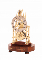 A small English brass skeleton clock with balance, circa 1840.