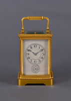 A French gilded travel clock in a Corniche case signed Le Roy & Fils, around 1860