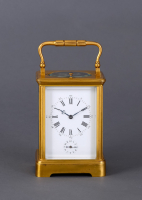 A French gilded quarter-striking carriage clock in a Corniche case with original travel case