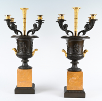 A pair of bronze and ormolu Charles X coupes / candlesticks.