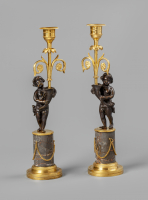 Pair of Louis Seize candlesticks with putti