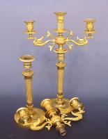 A pair of Empire ormolu bronze three-light candelabra, circa. 1820