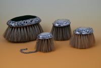 Four brushes, silver mounted