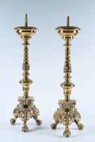 A pair of brass, 17th century candlesticks