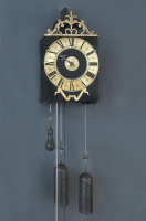 An early French provincial iron and brass Morbier wall clock with iron pointer, 1730