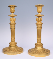 A pair of  ormolu bronze Empire candlesticks
