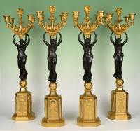 A set of four large Empire candelabra