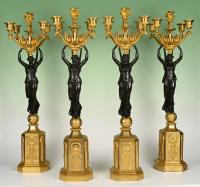 Een set van vier grote vijflichts Empire kandelaars