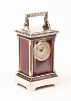 A miniature Swiss silver guilloche translucent enamel travel clock, circa 1900.