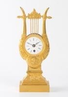 A small French Charles X ormolu lyre mantel timepiece, circa 1830