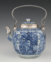 A large porcelain Wanli teapot with silver mount.