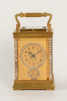 An attractive French brass paste set Anglaise carriage clock with alarm, circa 1900.
