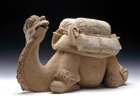 A reclining pottery camel Tang ceramic