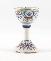 A Polychrome Decorated Egg Cup in Dutch Delftware