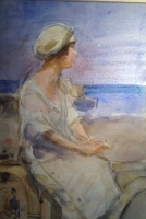 Sitting lady at the beach
