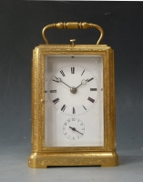 A fine 'one piece case', engraved and gilded carriage clock, striking and alarm, Jura ca. 1840.