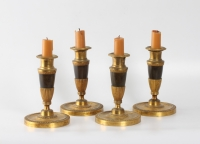 A set of four French Empire bronze and ormolu candle sticks, circa 1810