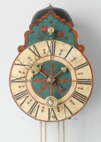 A South German polychrome painted wall clock, circa 1710