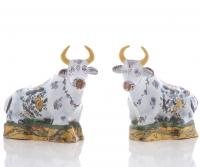 A Pair Polychrome Recumbing Cows in Dutch Delftware
