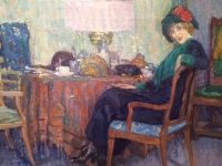 Interior, at the table a seated woman with blue hat