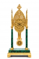 A russian neo-Gothic ormolu and malachite veneered mantel clock, circa 1830