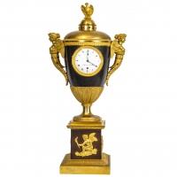 Een uitzonderlijk zeldzame Franse verguld en gepatineerd bronzen nacht-projectie klok, vroeg 19e eeuw