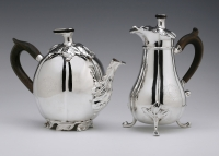 An antique Dutch silver teapot and milk jug