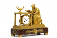 A rare French Empire ormolu mantel clock, Sappho, circa 1800