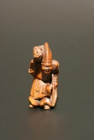 A wooden netsuke: mythological figure