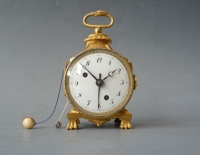 A Swiss Louis XVI- gilt brass miniature  'pendule d'officier'  with alarm, circa 1800.