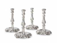 Set of four silver candlesticks