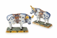 Pair of polychrome figures of cows