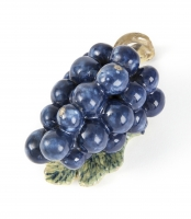 Polychrome figure of grapes