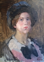 Portrait of a young woman wearing a hat